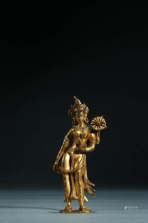 A gilt-bronze figure of white tara