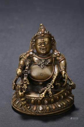 A small bronze silver inlaid bodhisattva