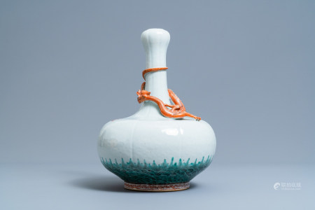 A Chinese white-glazed garlic head vase with an applied dragon, 19th C.