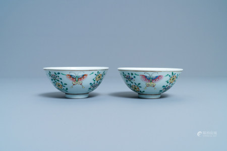 A pair of Chinese famille rose rice grain pattern 'butterfly' bowls, Qianlong mark, 19th C.