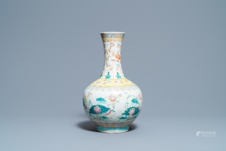 A Chinese famille rose bottle vase with mandarin ducks in a lotus pond, 19th C.