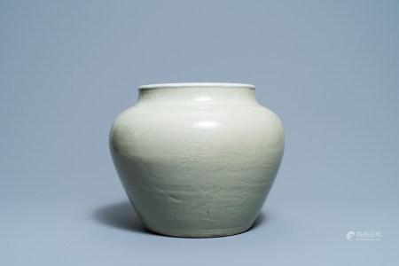A globular Chinese monochrome celadon 'dragon' vase, Kangxi