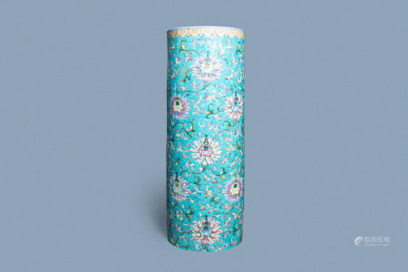 A large Chinese famille rose cylindrical vase with molded lotus scrolls, Jiaqing/Daoguang
