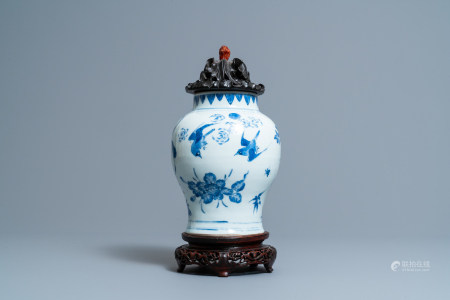 A Chinese blue and white vase with birds among blossoms, Transitional period