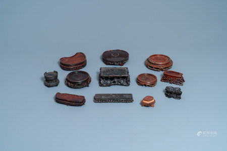 Twelve Chinese reticulated carved wooden stands, 19/20th C.
