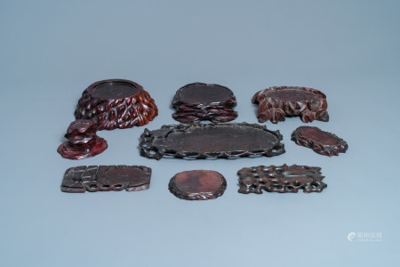 Nine Chinese naturalistically carved wooden stands, 19/20th C.