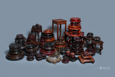 64 Chinese carved wooden stands, 19/20th C.