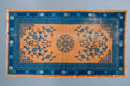 A large Chinese rectangular carpet, 19th C.