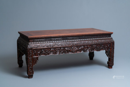 A Chinese huanghuali wood 'kangzhuo' low table, 18th C.