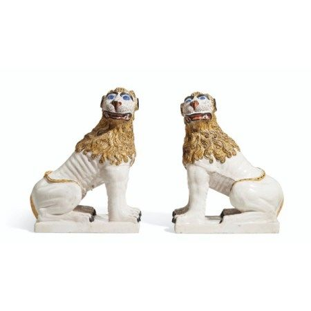A LARGE PAIR OF FRENCH FAIENCE MODELS OF SEATED LIONS 19TH/20TH CENTURY