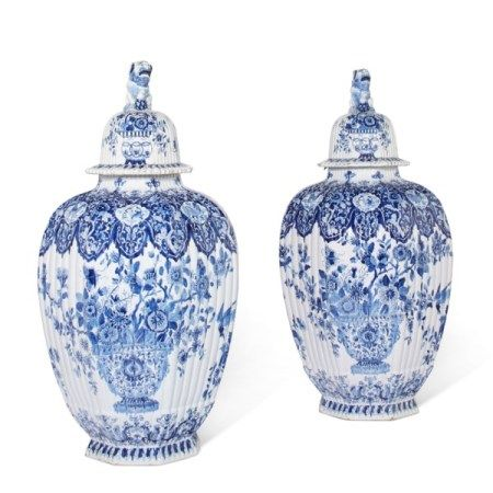 A PAIR OF DUTCH DELFT BLUE AND WHITE OCTAGONAL VASES AND COVERS 19TH CENTURY