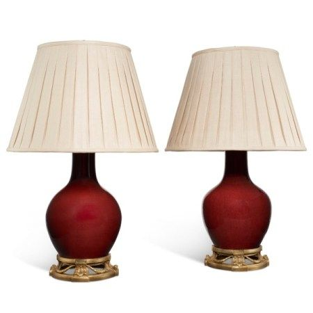 A MATCHED PAIR OF CHINESE COPPER RED-GLAZED VASES, MOUNTED AS LAMPS THE PORCELAIN LATE QING DYNASTY, 19TH CENTURY/EARLY 20TH CENTURY, THE MOUNTS LATER