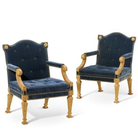 A PAIR OF GEORGE II GILTWOOD ARMCHAIRS AFTER A DESIGN BY WILLIAM KENT, CIRCA 1740