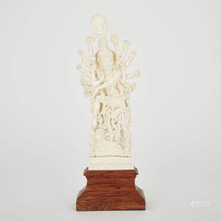 A CARVED IVORY INDIAN DEITY, CIRCA 1940