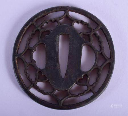 AN 18TH/19TH CENTURY JAPANESE IRON TSUBA of openwork form. 5.5 cm wide.