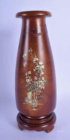 AN EARLY 20TH CENTURY CHINESE HARDWOOD MOTHER OF PEARL VASE inlaid with mother of pearl foliage. 27 cm high.