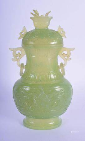 AN EARLY 20TH CENTURY CHINESE TWIN HANDLED JADE VASE AND COVER Late Qing, decorated with taotie mask heads and motifs. 20 cm x 8 cm.