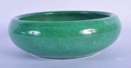 A CHINESE QING DYNASTY MONOCHROME GREEN GLAZED BRUSH WASHER CENSER of plain form. 15 cm wide.