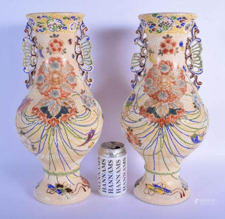 A LARGE PAIR OF EARLY 20TH CENTURY JAPANESE MEIJI PERIOD TWIN HANDLED VASES enamelled with flowers and vines. 40 cm x 15 cm.