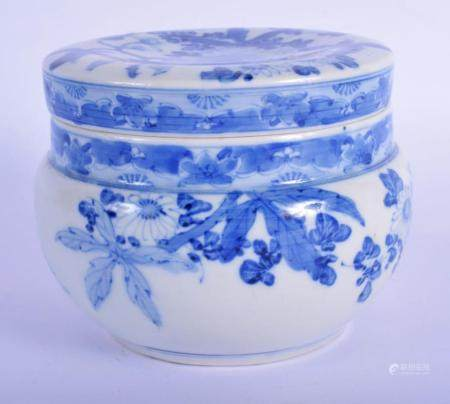 A 19TH CENTURY JAPANESE BLUE AND WHITE PORCELAIN JAR AND COVER painted with flowers. 11 cm wide.