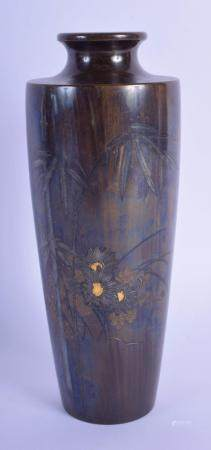 A 19TH CENTURY JAPANESE MEIJI PERIOD BRONZE TAPERING VASE inlaid with flowers and flowering bamboo. 19 cm high.