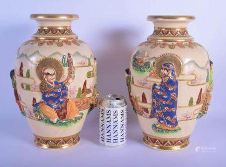 A LARGE PAIR OF EARLY 20TH CENTURY JAPANESE MEIJI PERIOD SATSUMA VASES decorated in figures within a landscape. 32 cm x 15 cm.