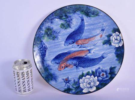 A JAPANESE TAISHO PERIOD PORCELAIN BLUE AND WHITE DISH decorated with swimming carp. 30 cm diameter.