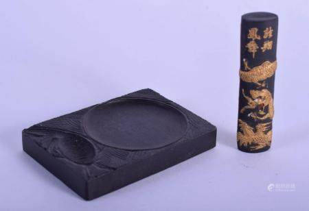 AN EARLY 20TH CENTURY CHINESE CARVED BLACK INK STONE BRUSH WASHER together with a dragon ink stick. Largest 7.25 cm x 5 cm. (2)