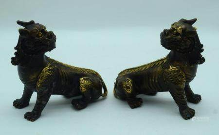 A pair of Chinese bronze Kylin 14 x 13cm (2).