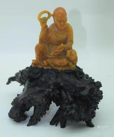 A Chinese soapstone carving of a scholar sitting on a hardwood stand 18.5 cm (2).