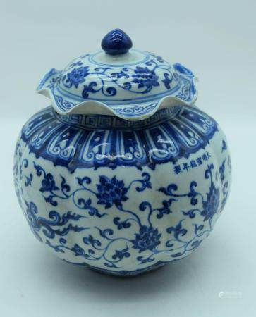 A Chinese porcelain blue and white jar with cover decorated with Lotus and Phoenix 25cm (2)