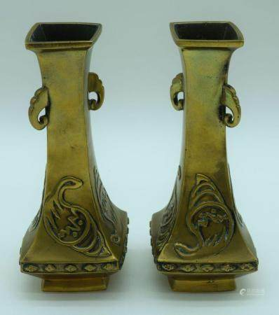 A pair of Chinese Tibetan bronze vases with elephant head handles and decorated with fruiting pods 23cm