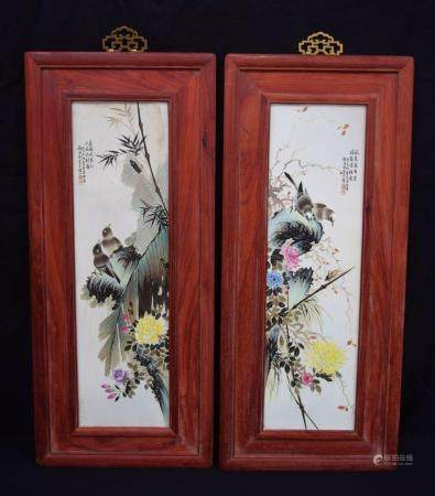 A pair of Chinese porcelain panels in Hongmu frames decorated with birds and foliage. 73 x 21cm (2).
