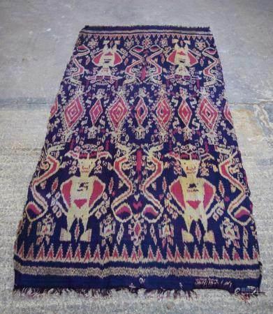 An Indonesian Ikat fabric 115 x 230cm.