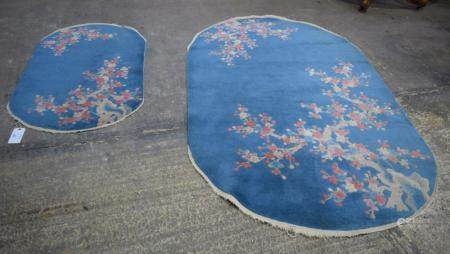 A Chinese blue ground Art Deco Oval Rugs together with another smaller rug 225 X 136 cm (2)