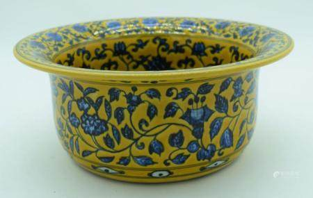 A large Chinese yellow ground porcelain wash bowl decorated with blue foliage. 13.5 x 32cm