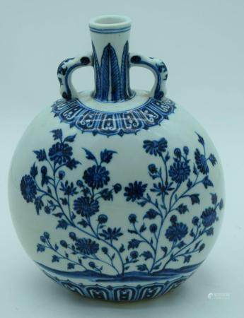 A Chinese porcelain blue and white Moon flask decorated with Lotus. 28cm.
