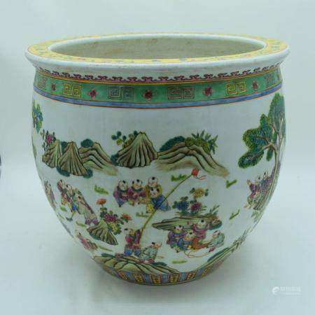 A large Chinese Polychrome porcelain fish bowl decorated with children .35 x 41cm