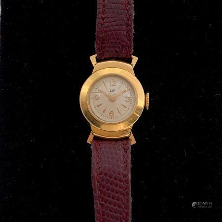 . LIP BRACELET MONTRE ronde de dame en or jaune (750). Attaches géométriques, cadran satiné, ch