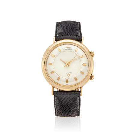 LECOULTRE. A GOLD FILLED BUMPER AUTOMATIC ALARM WRISTWATCH Memovox,