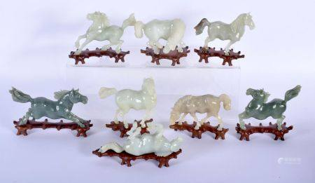 A SET OF EIGHT EARLY 20TH CENTURY CHINESE CARVED JADE FIGURES OF HORSES contained within original bo