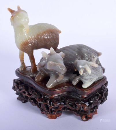 A FINE EARLY 20TH CENTURY CHINESE CARVED THREE COLOUR JADE GROUP depicting rams upon a well carved h