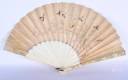 A FINE LARGE 19TH CENTURY CHINESE CANTON IVORY AND SILK FAN Qing, decorated with figures in various