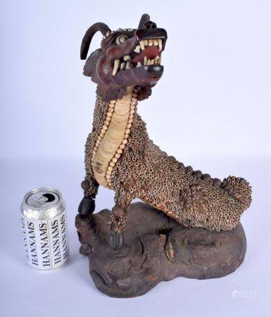 A LARGE 19TH CENTURY CHINESE ASIAN SHELL AND CORAL FIGURE OF A BUDDHIST BEAST modelled upon a natura