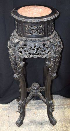 A 19TH CENTURY CHINESE MARBLE INSET PEDESTAL STAND carved with animals and foliage. 90 cm x 30 cm.