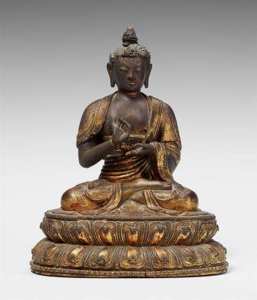 A very fine Sinotibetan red lacquered and gilt wooden figure of Buddha. 16th century