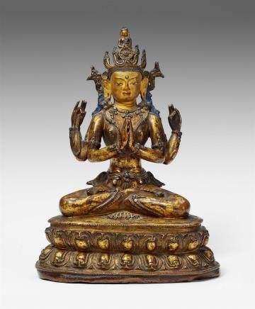A Tibetan gilt bronze figure of Shadakshari Avalokiteshvara. 15th/16th  century