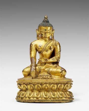 A Tibetan gilt bronze figure of Buddha Shakyamuni with vajra. 15th century