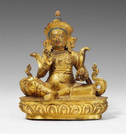 A Sinotibetan gilt bronze figure of Vaishravana. 18th century