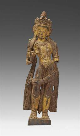 A Tibetan wooden figure of a bodhisattva. 17th/18th century